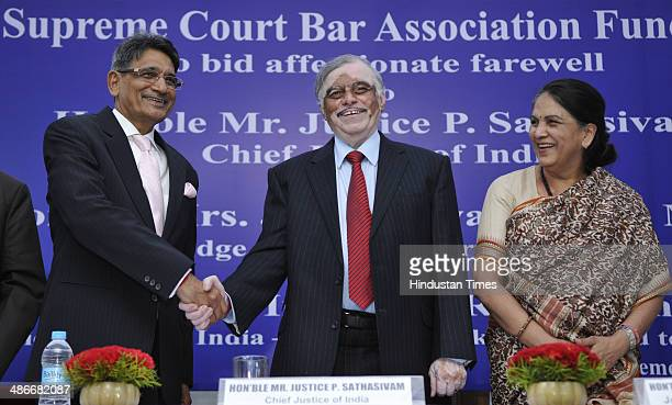 Designate Chief Justice of India Rajendra Mal Lodha shakes hand with outgoing CJI P Sathasivam Supreme Court Judge Gyan Sudha Misra during farewell...