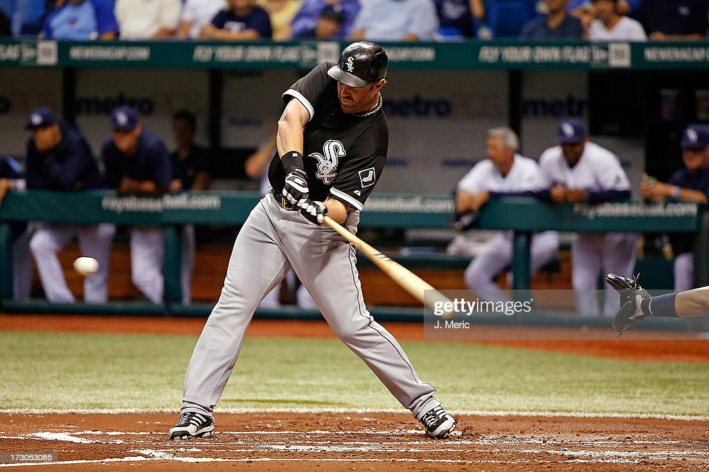 Designated hitter <a gi-track='captionPersonalityLinkClicked' href=/galleries/search?phrase=Adam+Dunn&family=editorial&specificpeople=213505 ng-click='$event.stopPropagation()'>Adam Dunn</a> #32 of the Chicago White Sox fouls off a pitch against the Tampa Bay Rays during the game at Tropicana Field on July 5, 2013 in St. Petersburg, Florida.