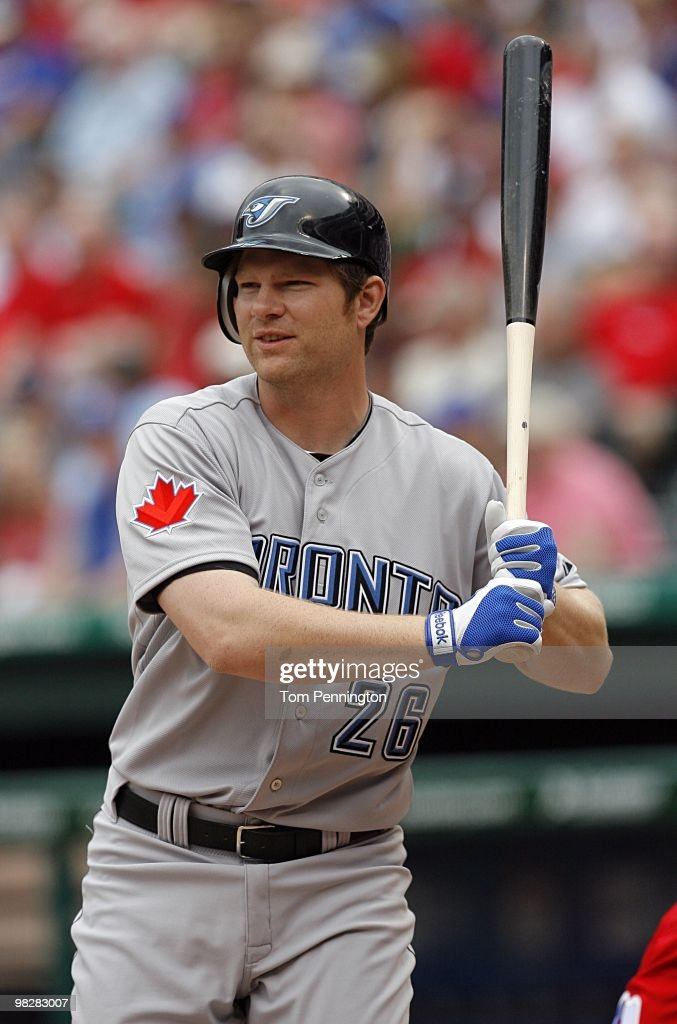 Designated hitter <a gi-track='captionPersonalityLinkClicked' href=/galleries/search?phrase=Adam+Lind&family=editorial&specificpeople=3911783 ng-click='$event.stopPropagation()'>Adam Lind</a> #26 of the Toronto Blue Jays steps to the plate against the Texas Rangers on Opening Day at Rangers Ballpark on April 5, 2010 in Arlington, Texas.
