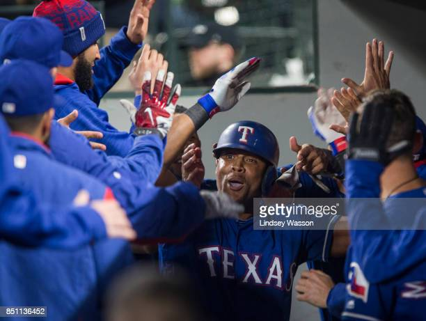 Designated hitter Adrian Beltre of the Texas Rangers is congratulated in the dugout after hitting a solo home run in the sixth inning off of Dan...