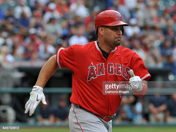 Designated hitter Albert Pujols of the Los Angeles Angels runs toward first base after hitting an RBI single in the first inning of a game against...