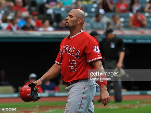 Designated hitter Albert Pujols of the Los Angeles Angels walks off the field after the first inning of a game against the Cleveland Indians on...