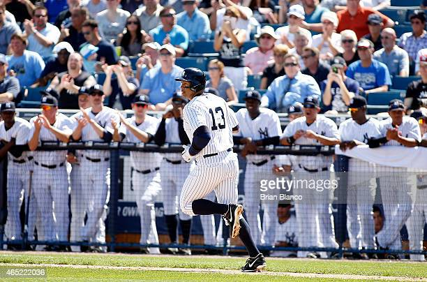 Designated hitter Alex Rodriguez of the New York Yankees runs to first base after hitting a single to left field off of pitcher Kevin Slowey of the...