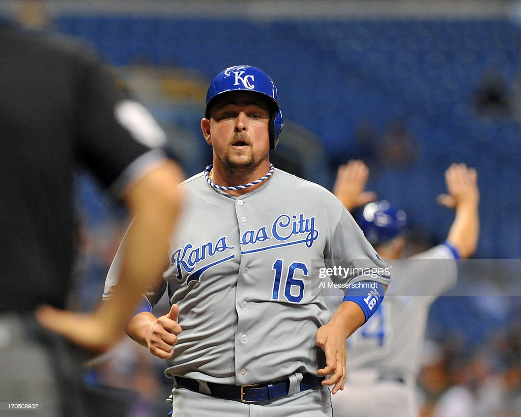 Designated hitter <a gi-track='captionPersonalityLinkClicked' href=/galleries/search?phrase=Billy+Butler&family=editorial&specificpeople=759092 ng-click='$event.stopPropagation()'>Billy Butler</a> #16 of the Kansas City Royals scores in the 8th inning against the Tampa Bay Rays June 13, 2013 at Tropicana Field in St. Petersburg, Florida. The Royals scored 8 runs in the inning.