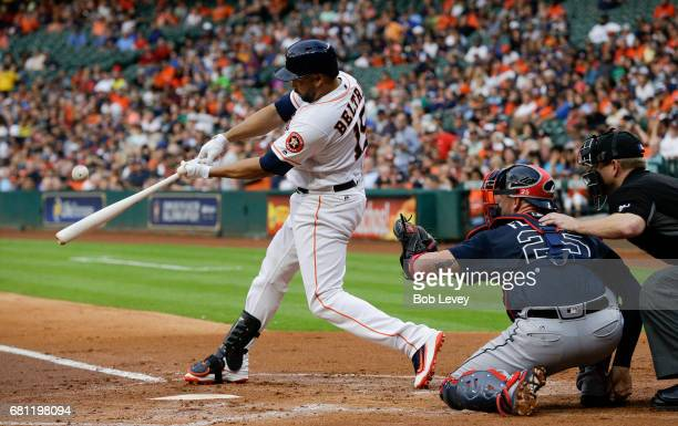 Designated hitter Carlos Beltran of the Houston Astros hits a home run in the first inning against the Atlanta Braves at Minute Maid Park on May 9...