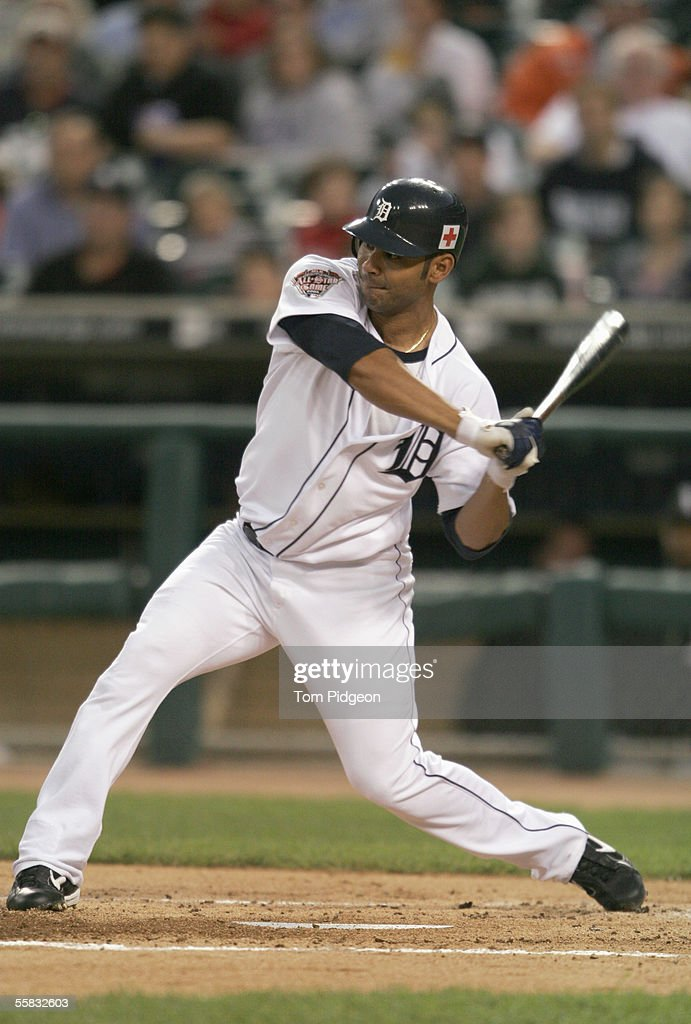 Designated hitter Carlos Pena#12 of the Detroit Tigers swings at the pitch during the game against the Chicago White Sox at Comerica Park on...