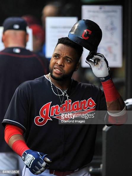 Designated hitter Carlos Santana of the Cleveland Indians walks through the dugout during a game against the Tampa Bay Rays on June 21 2016 at...