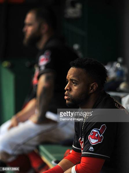 Designated hitter Carlos Santana of the Cleveland Indians watches the action from the dugout during a game against the Tampa Bay Rays on June 21 2016...