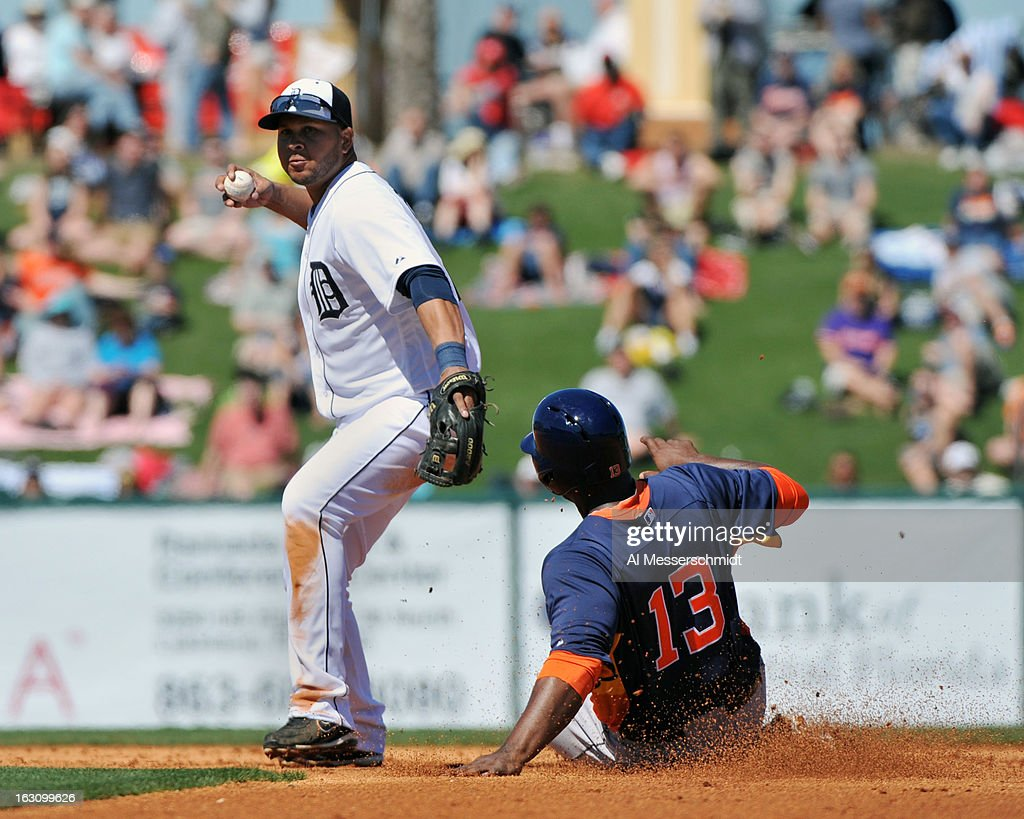 Designated hitter Chris Carter #13 of Houston Astros slides into second base as shortstop <a gi-track='captionPersonalityLinkClicked' href=/galleries/search?phrase=Jhonny+Peralta&family=editorial&specificpeople=213286 ng-click='$event.stopPropagation()'>Jhonny Peralta</a> #27 of the Detroit Tigers throws to first base March 4, 2013 at Joker Marchant Stadium in Lakeland, Florida.