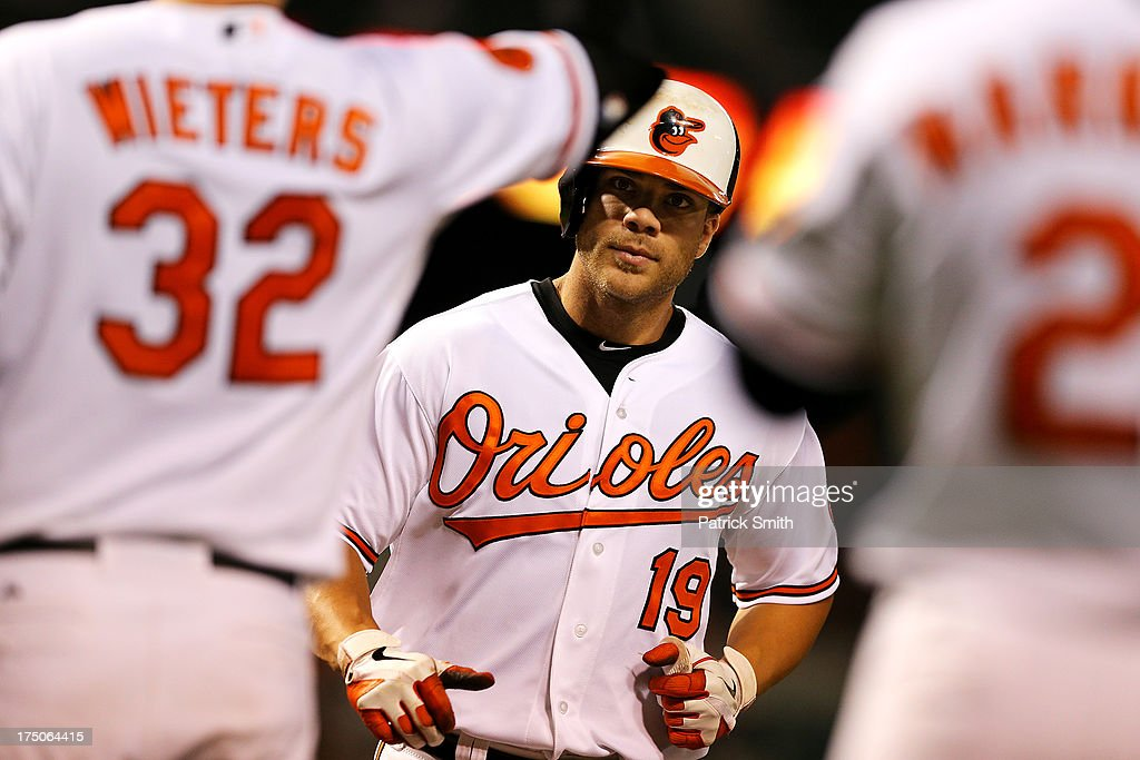 Designated hitter Chris Davis #19 of the Baltimore Orioles crosses home plate after hitting a home run against the Houston Astros in the sixth inning at Oriole Park at Camden Yards on July 30, 2013 in Baltimore, Maryland. The Baltimore Orioles won, 4-3.