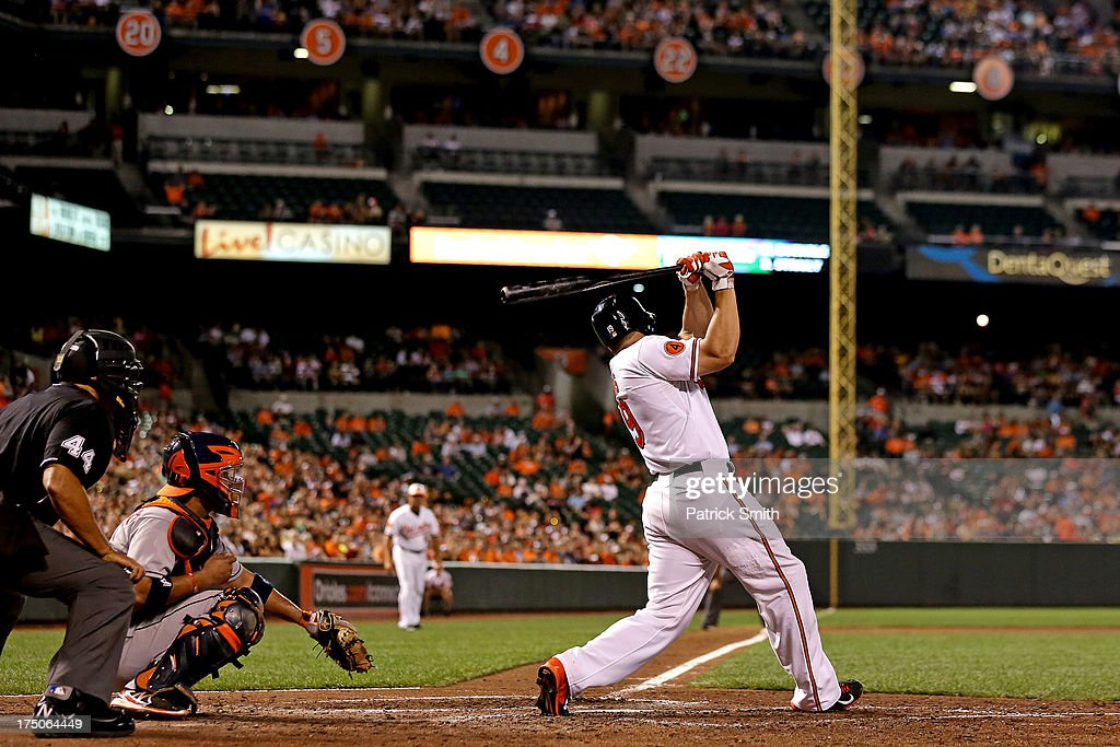 Designated hitter Chris Davis #19 of the Baltimore Orioles hits a home run against the Houston Astros in the sixth inning at Oriole Park at Camden Yards on July 30, 2013 in Baltimore, Maryland. The Baltimore Orioles won, 4-3.