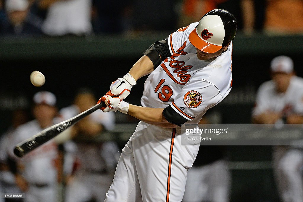Designated hitter Chris Davis #19 of the Baltimore Orioles hits the game-winning RBI against the Boston Red Sox in the 13th-inning at Oriole Park at Camden Yards on June 13, 2013 in Baltimore, Maryland. The Baltimore Orioles won, 5-4, in 13-innings.