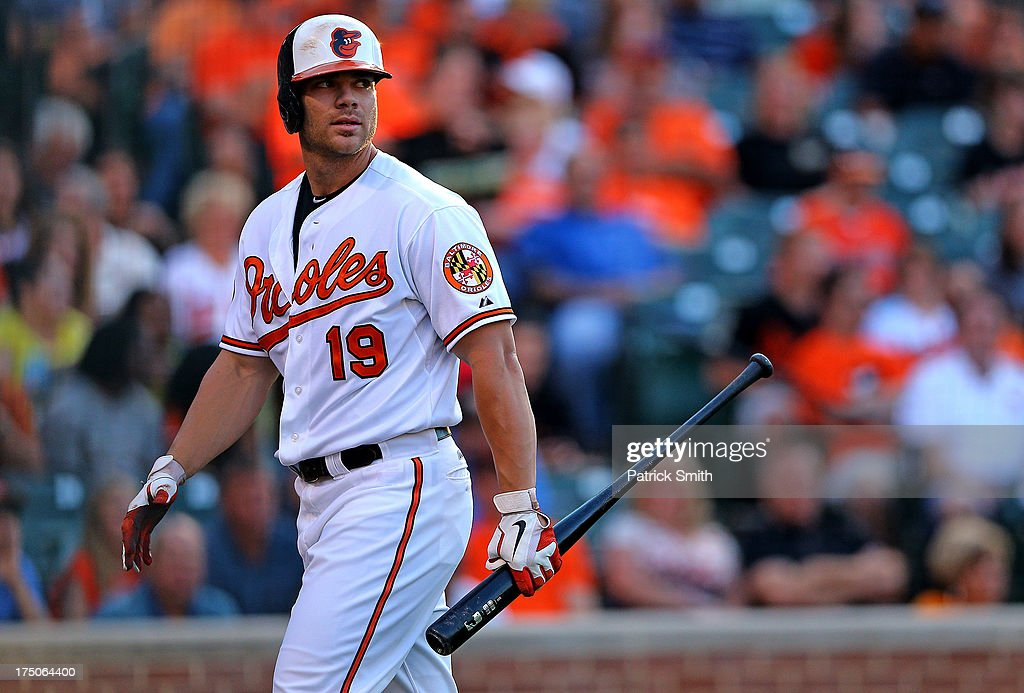 Designated hitter Chris Davis #19 of the Baltimore Orioles reacts after striking out in the second inning against the Houston Astros at Oriole Park at Camden Yards on July 30, 2013 in Baltimore, Maryland.