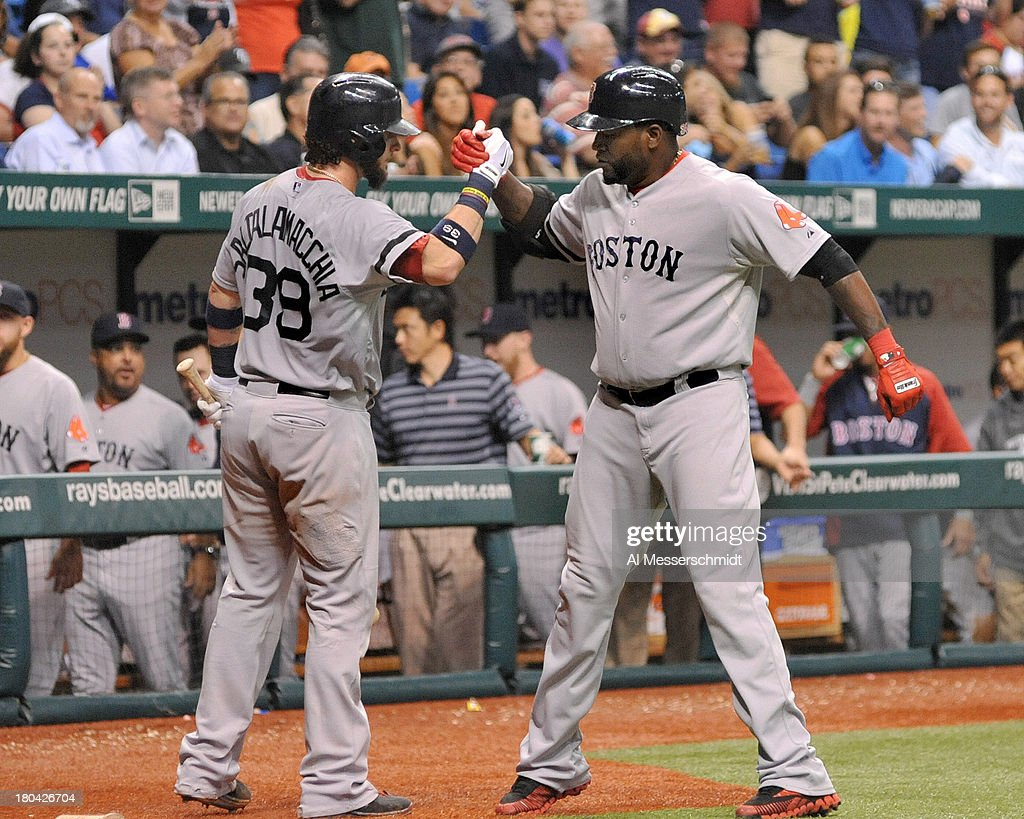 Designated hitter David Ortiz #34 of the Boston Red Sox celebrates a 6th-inning home run against the Tampa Bay Rays September 12, 2013 at Tropicana Field in St. Petersburg, Florida.