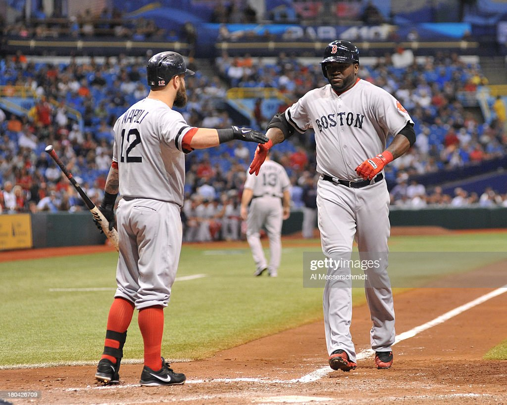 Designated hitter <a gi-track='captionPersonalityLinkClicked' href=/galleries/search?phrase=David+Ortiz&family=editorial&specificpeople=175825 ng-click='$event.stopPropagation()'>David Ortiz</a> #34 of the Boston Red Sox celebrates a 6th-inning home run against the Tampa Bay Rays September 12, 2013 at Tropicana Field in St. Petersburg, Florida.