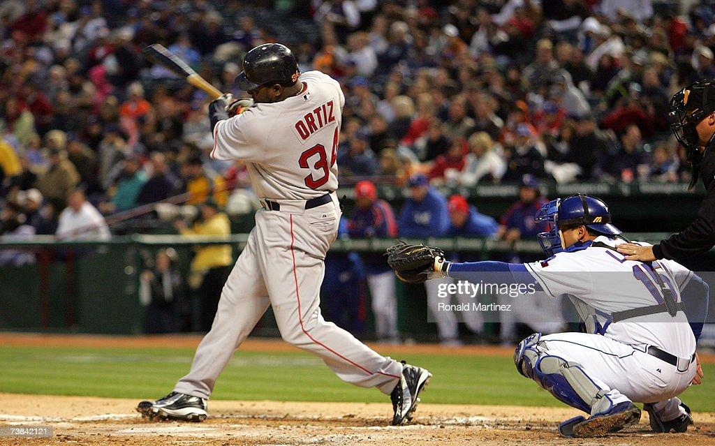 Designated hitter David Ortiz of the Boston Red Sox hits a tworun homerun against the Texas Rangers at Rangers Ballpark April 8 2007 in Arlington...