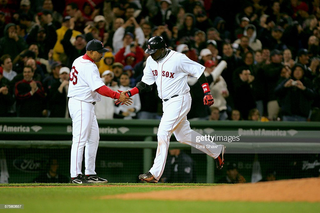 Designated hitter David Ortiz of the Boston Red Sox shakes hands with his third base coach DeMarlo Hale after Ortiz scored a homerun against the New...