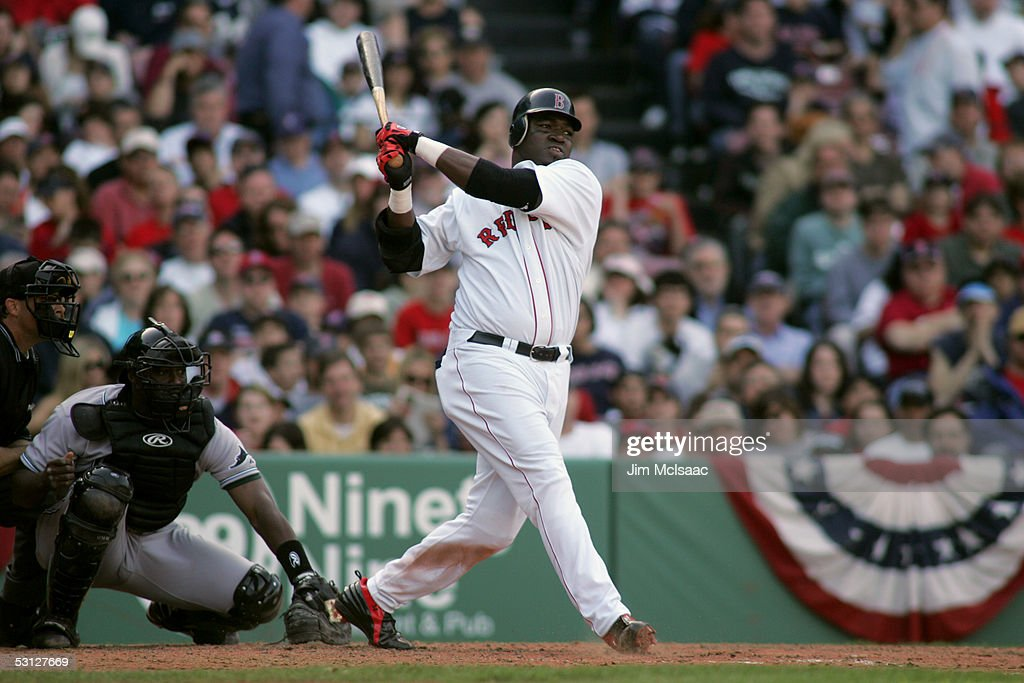 Designated hitter David Ortiz of the Boston Red Sox swings at a Tampa Bay Devil Rays pitch during the game at Fenway Park on April 17 2005 in Boston...
