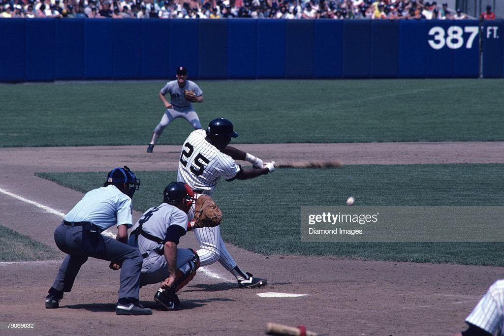 Designated hitter Don Baylor #25 of the New York Yankees at bat during a game on July 4, 1983 against the Boston Red Sox at Yankee Stadium in New York, New York. The Red Sox catcher is Jeff Newman and the home plate umpire is Steve Palermo. 83-01841B