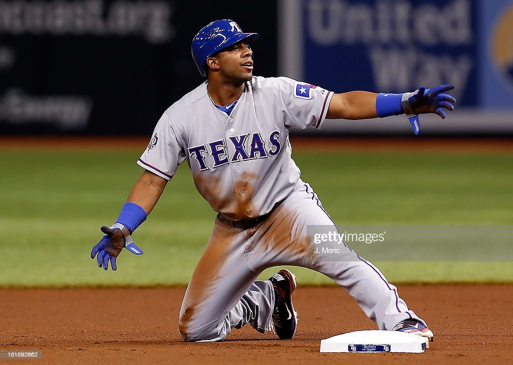 Designated hitter <a gi-track='captionPersonalityLinkClicked' href=/galleries/search?phrase=Elvis+Andrus&family=editorial&specificpeople=4845974 ng-click='$event.stopPropagation()'>Elvis Andrus</a> #1 of the Texas Rangers pleads his case after he was called out on a steal attempt against the Tampa Bay Rays during the game at Tropicana Field on September 8, 2012 in St. Petersburg, Florida.