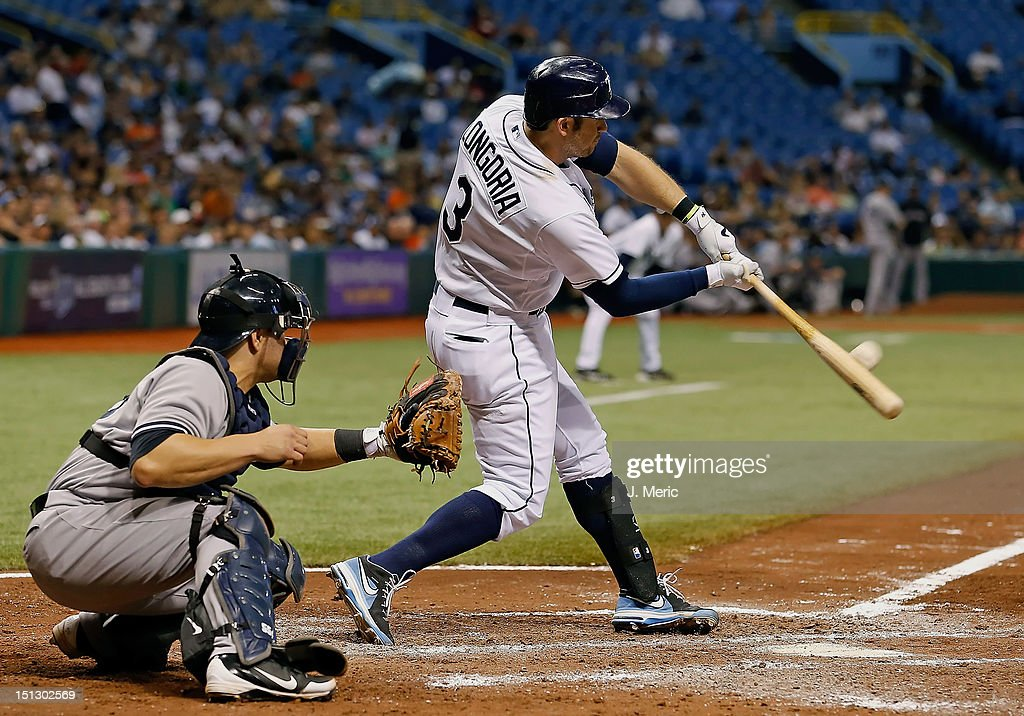 Designated hitter <a gi-track='captionPersonalityLinkClicked' href=/galleries/search?phrase=Evan+Longoria&family=editorial&specificpeople=2349329 ng-click='$event.stopPropagation()'>Evan Longoria</a> #3 of the Tampa Bay Rays fouls off a pitch against the New York Yankees during the game at Tropicana Field on September 5, 2012 in St. Petersburg, Florida.