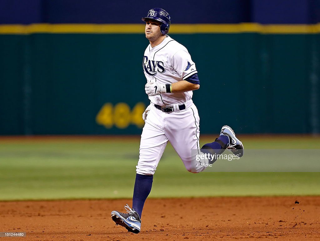 Designated hitter <a gi-track='captionPersonalityLinkClicked' href=/galleries/search?phrase=Evan+Longoria&family=editorial&specificpeople=2349329 ng-click='$event.stopPropagation()'>Evan Longoria</a> #3 of the Tampa Bay Rays rounds the bases after his two run home run against the New York Yankees during the game at Tropicana Field on September 4, 2012 in St. Petersburg, Florida.