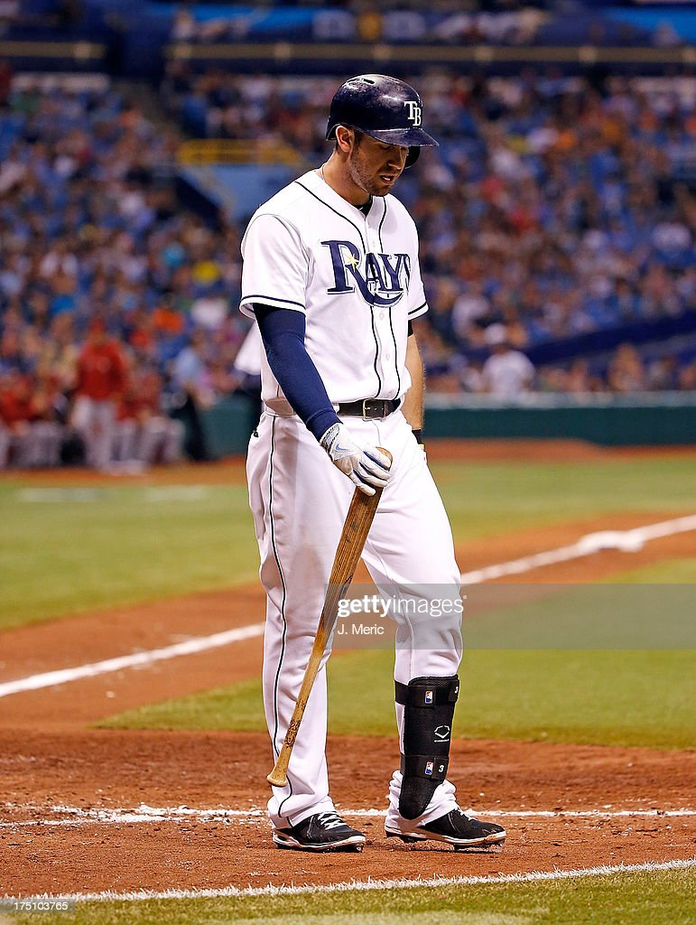Designated hitter <a gi-track='captionPersonalityLinkClicked' href=/galleries/search?phrase=Evan+Longoria&family=editorial&specificpeople=2349329 ng-click='$event.stopPropagation()'>Evan Longoria</a> #3 of the Tampa Bay Rays strikes out to end the seventh inning against the Arizona Diamondbacks during the game at Tropicana Field on July 31, 2013 in St. Petersburg, Florida.