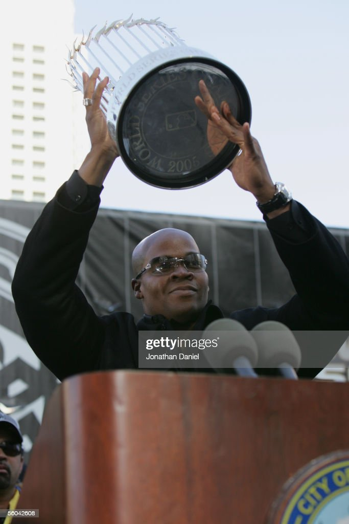 Designated hitter Frank Thomas at the Chicago White Sox holds the World Series Trophy during the victory parade on October 28 2005 in Chicago...