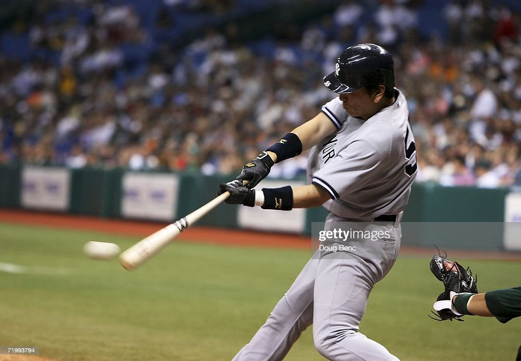 Designated hitter Hideki Matsui of the New York Yankees singles against the Tampa Bay Devil Rays at Tropicana Field September 25 2006 in St...