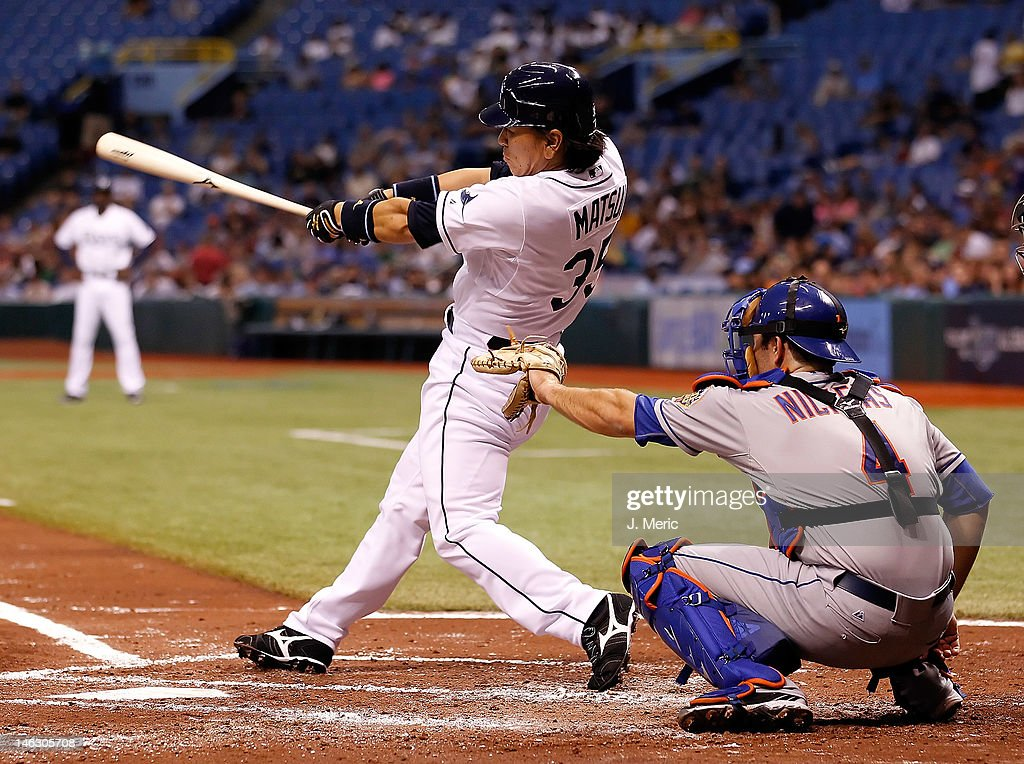 Designated hitter <a gi-track='captionPersonalityLinkClicked' href=/galleries/search?phrase=Hideki+Matsui&family=editorial&specificpeople=157483 ng-click='$event.stopPropagation()'>Hideki Matsui</a> #35 of the Tampa Bay Rays fouls off a pitch against the New York Mets during the game at Tropicana Field on June 13, 2012 in St. Petersburg, Florida.