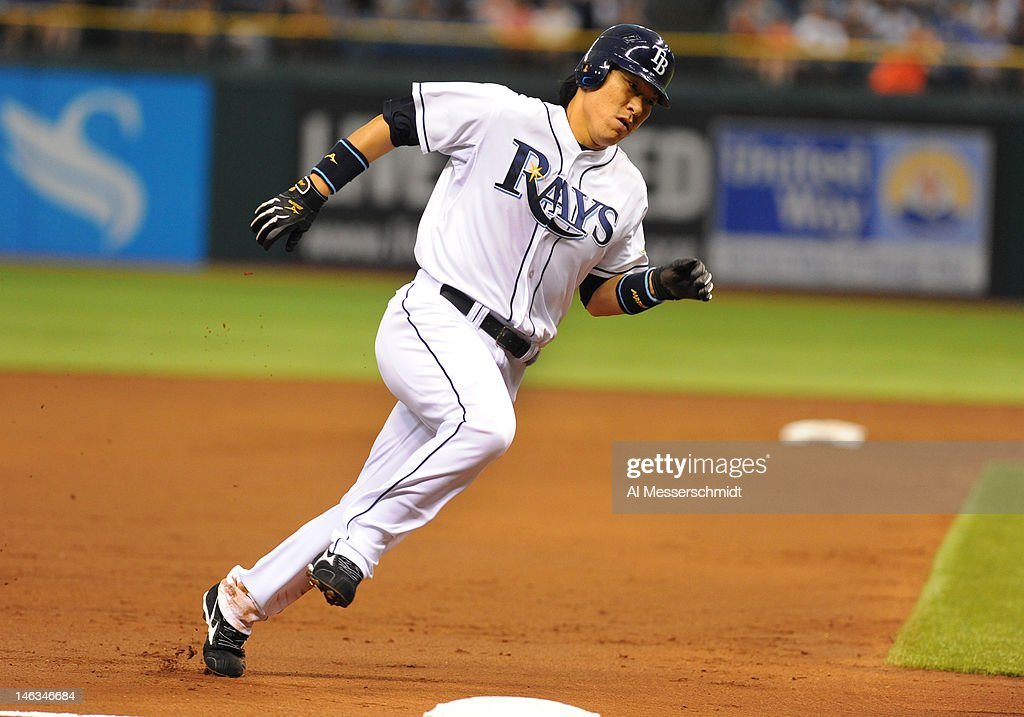 Designated hitter <a gi-track='captionPersonalityLinkClicked' href=/galleries/search?phrase=Hideki+Matsui&family=editorial&specificpeople=157483 ng-click='$event.stopPropagation()'>Hideki Matsui</a> #35 of the Tampa Bay Rays rounds third base for a run against the New York Mets June 14, 2012 at Tropicana Field in St. Petersburg, Florida.