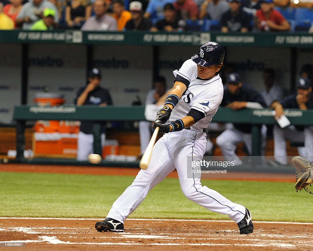 Designated hitter <a gi-track='captionPersonalityLinkClicked' href=/galleries/search?phrase=Hideki+Matsui&family=editorial&specificpeople=157483 ng-click='$event.stopPropagation()'>Hideki Matsui</a> #35 of the Tampa Bay Rays singles against the New York Mets June 14, 2012 at Tropicana Field in St. Petersburg, Florida.