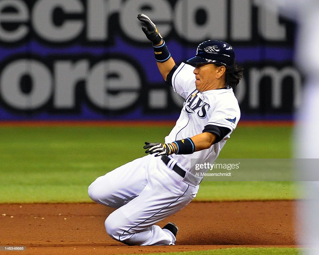 Designated hitter <a gi-track='captionPersonalityLinkClicked' href=/galleries/search?phrase=Hideki+Matsui&family=editorial&specificpeople=157483 ng-click='$event.stopPropagation()'>Hideki Matsui</a> #35 of the Tampa Bay Rays slides into second base against the New York Mets June 14, 2012 at Tropicana Field in St. Petersburg, Florida.