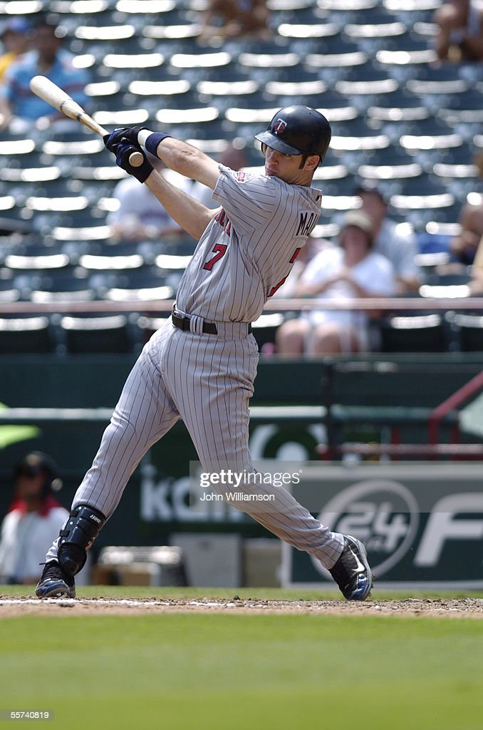 Designated hitter Joe Mauer of the Minnesota Twins bats during the game against the Texas Rangers at Ameriquest Field in Arlington on August 27 2005...