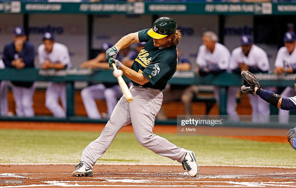 Designated hitter <a gi-track='captionPersonalityLinkClicked' href=/galleries/search?phrase=John+Jaso&family=editorial&specificpeople=4951282 ng-click='$event.stopPropagation()'>John Jaso</a> #5 of the Oakland Athletics fouls off a pitch against the Tampa Bay Rays during the game at Tropicana Field on April 20, 2013 in St. Petersburg, Florida.