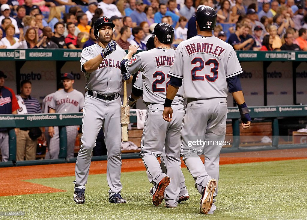 Designated hitter <a gi-track='captionPersonalityLinkClicked' href=/galleries/search?phrase=Johnny+Damon&family=editorial&specificpeople=167164 ng-click='$event.stopPropagation()'>Johnny Damon</a> #33 of the Cleveland Indians congratulates <a gi-track='captionPersonalityLinkClicked' href=/galleries/search?phrase=Jason+Kipnis&family=editorial&specificpeople=5330784 ng-click='$event.stopPropagation()'>Jason Kipnis</a> #22 and Michael Brantley #23 after they scored against the Tampa Bay Rays during the game at Tropicana Field on July 18, 2012 in St. Petersburg, Florida.