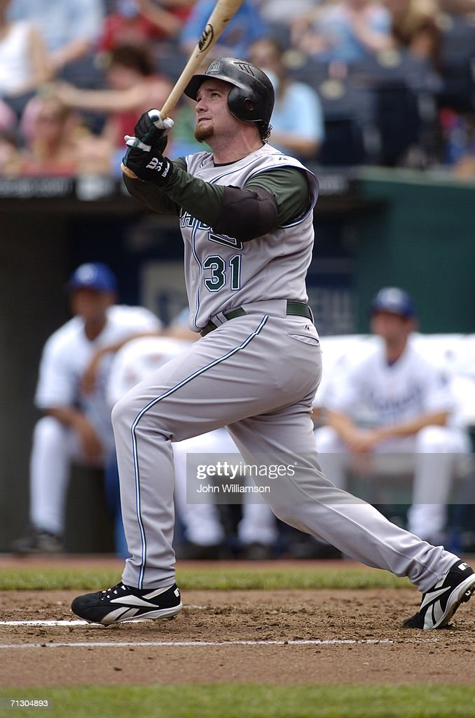 Designated hitter Jonny Gomes of the Tampa Bay Devil Rays bats during the game against the Kansas City Royals at Kauffman Stadium on June 11 2006 in...