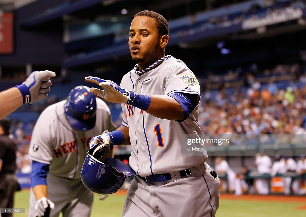 Designated hitter Jordany Valdespin #1 of the New York Mets is congratulated after scoring against the Tampa Bay Rays looks on during the game at Tropicana Field on June 12, 2012 in St. Petersburg, Florida.