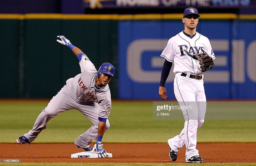 Designated hitter Jordany Valdespin #1 of the New York Mets steals second base as <a gi-track='captionPersonalityLinkClicked' href=/galleries/search?phrase=Sean+Rodriguez&family=editorial&specificpeople=4171805 ng-click='$event.stopPropagation()'>Sean Rodriguez</a> #1 of the Tampa Bay Rays looks on during the game at Tropicana Field on June 12, 2012 in St. Petersburg, Florida.