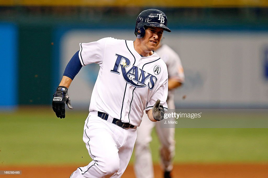 Designated hitter Kelly Johnson #2 of the Tampa Bay Rays rounds third base against the Baltimore Orioles during the Opening Day game at Tropicana Field on April 2, 2013 in St. Petersburg, Florida.