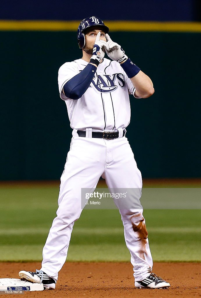 Designated hitter <a gi-track='captionPersonalityLinkClicked' href=/galleries/search?phrase=Luke+Scott&family=editorial&specificpeople=757156 ng-click='$event.stopPropagation()'>Luke Scott</a> #30 of the Tampa Bay Rays celebrates his double against the Boston Red Sox during the game at Tropicana Field on September 19, 2012 in St. Petersburg, Florida.