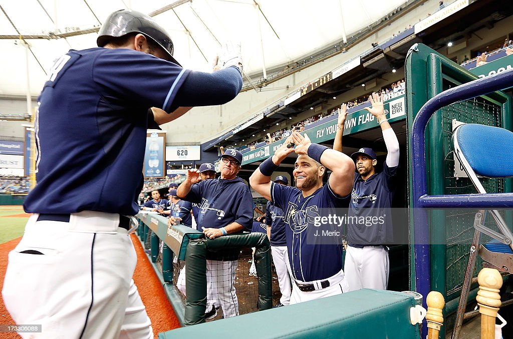 Designated hitter <a gi-track='captionPersonalityLinkClicked' href=/galleries/search?phrase=Luke+Scott&family=editorial&specificpeople=757156 ng-click='$event.stopPropagation()'>Luke Scott</a> #30 of the Tampa Bay Rays congratulates <a gi-track='captionPersonalityLinkClicked' href=/galleries/search?phrase=Evan+Longoria&family=editorial&specificpeople=2349329 ng-click='$event.stopPropagation()'>Evan Longoria</a> #3 after his home run against the Minnesota Twins during the game at Tropicana Field on July 11, 2013 in St. Petersburg, Florida.
