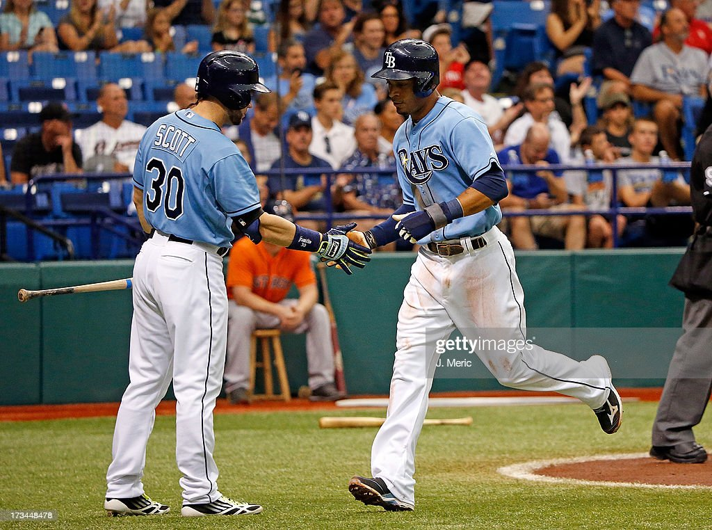 Designated hitter <a gi-track='captionPersonalityLinkClicked' href=/galleries/search?phrase=Luke+Scott&family=editorial&specificpeople=757156 ng-click='$event.stopPropagation()'>Luke Scott</a> #30 of the Tampa Bay Rays congratulates <a gi-track='captionPersonalityLinkClicked' href=/galleries/search?phrase=Desmond+Jennings&family=editorial&specificpeople=5974085 ng-click='$event.stopPropagation()'>Desmond Jennings</a> #8 after scoring a first inning run against the Houston Astros during the game at Tropicana Field on July 14, 2013 in St. Petersburg, Florida.