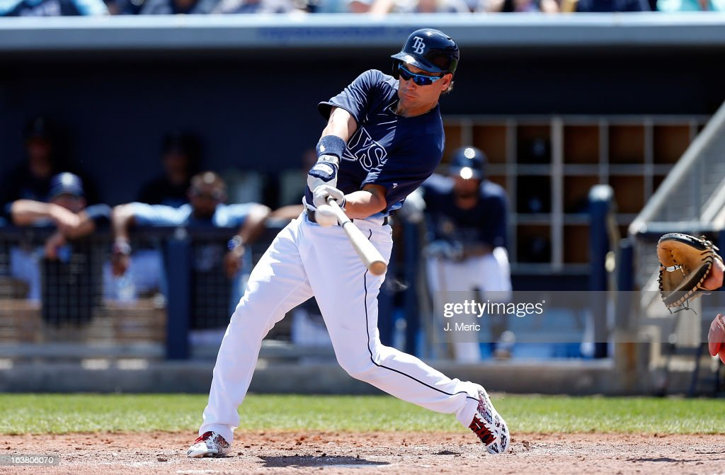 Designated hitter <a gi-track='captionPersonalityLinkClicked' href=/galleries/search?phrase=Luke+Scott&family=editorial&specificpeople=757156 ng-click='$event.stopPropagation()'>Luke Scott</a> #30 of the Tampa Bay Rays doubles against the Boston Red Sox during a Grapefruit League Spring Training Game at the Charlotte Sports Complex on March 16, 2013 in Port Charlotte, Florida.
