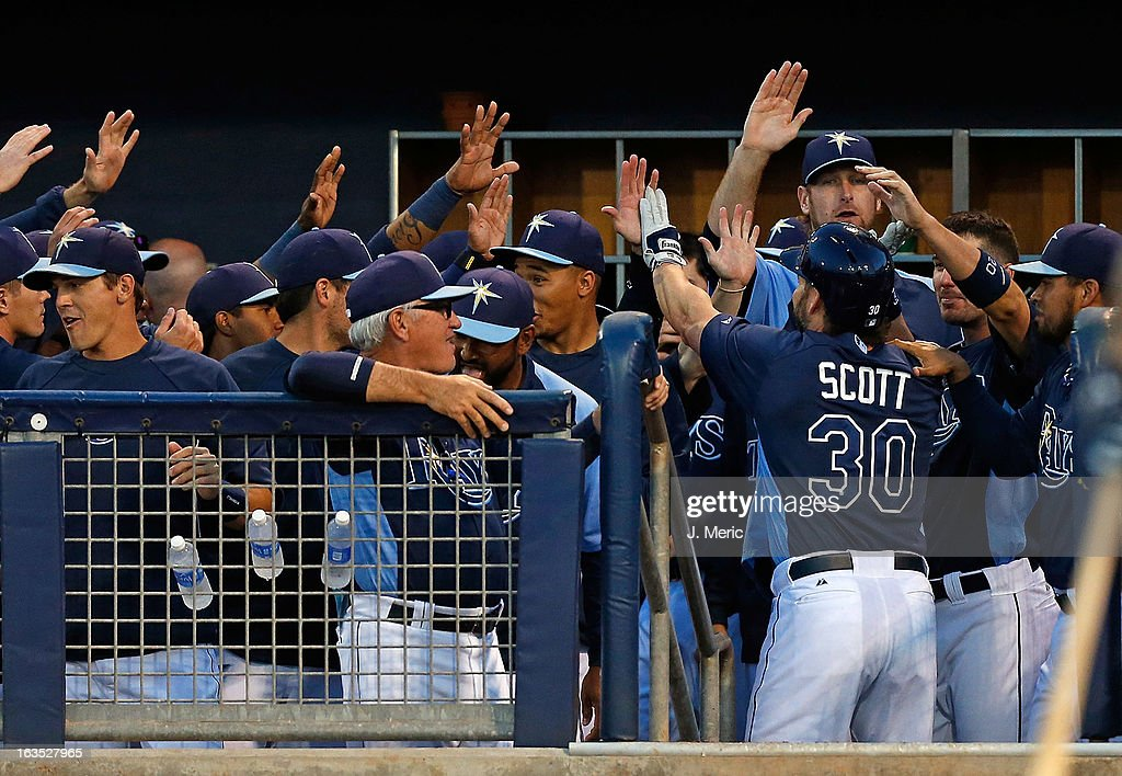 Designated hitter <a gi-track='captionPersonalityLinkClicked' href=/galleries/search?phrase=Luke+Scott&family=editorial&specificpeople=757156 ng-click='$event.stopPropagation()'>Luke Scott</a> #30 of the Tampa Bay Rays is congratulated after his home run against the Minnesota Twins during a Grapefruit League spring training game at the Charlotte Sports Complex on March 11, 2013 in Port Charlotte, Florida.
