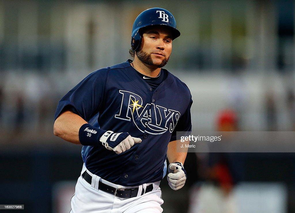 Designated hitter Luke Scott #30 of the Tampa Bay Rays rounds the bases after hitting a home run against the Minnesota Twins during a Grapefruit League spring training game at the Charlotte Sports Complex on March 11, 2013 in Port Charlotte, Florida.