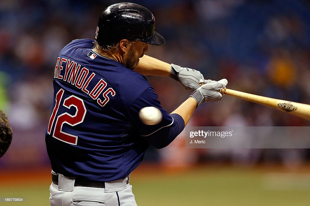 Designated hitter <a gi-track='captionPersonalityLinkClicked' href=/galleries/search?phrase=Mark+Reynolds&family=editorial&specificpeople=2343799 ng-click='$event.stopPropagation()'>Mark Reynolds</a> #12 of the Cleveland Indians swings at a second inning pitch against the Tampa Bay Rays during the game at Tropicana Field on April 5, 2013 in St. Petersburg, Florida.