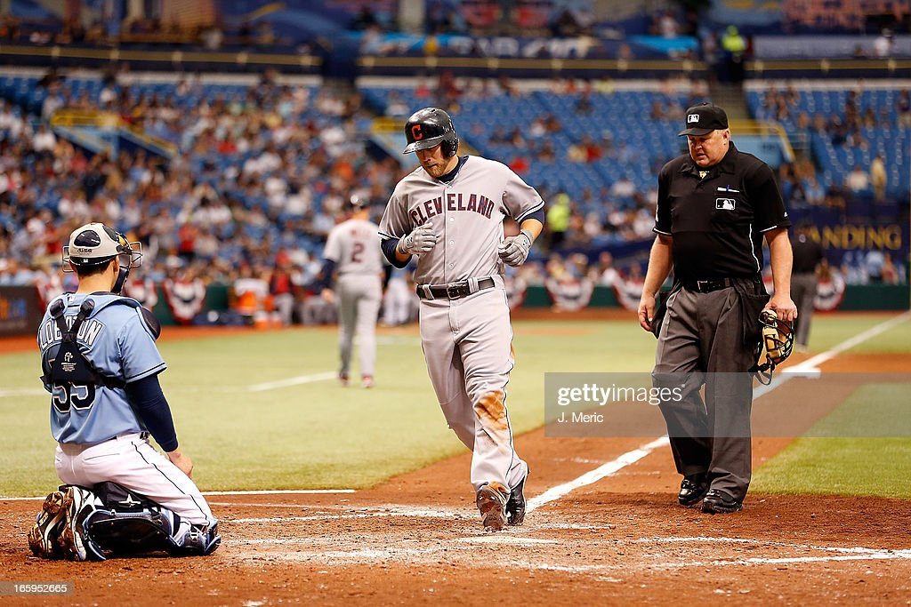 Designated hitter <a gi-track='captionPersonalityLinkClicked' href=/galleries/search?phrase=Mark+Reynolds&family=editorial&specificpeople=2343799 ng-click='$event.stopPropagation()'>Mark Reynolds</a> #12 of the Cleveland Indians touches homeplate after his seventh inning home run against the Tampa Bay Rays during the game at Tropicana Field on April 7, 2013 in St. Petersburg, Florida.