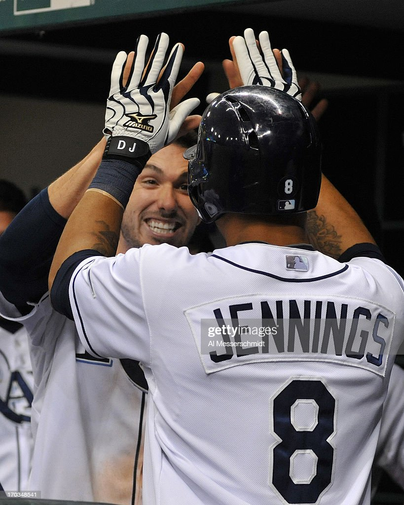 Designated hitter Matt Joyce #20 and outfielder <a gi-track='captionPersonalityLinkClicked' href=/galleries/search?phrase=Desmond+Jennings&family=editorial&specificpeople=5974085 ng-click='$event.stopPropagation()'>Desmond Jennings</a> #8 of the Tampa Bay Rays celebrate after back-to-back home runs in the 5th inning against the Boston Red Sox June 11, 2013 at Tropicana Field in St. Petersburg, Florida.