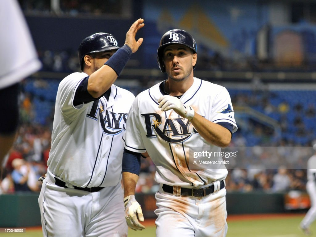 Designated hitter Matt Joyce of the Tampa Bay Rays celebrates with catcher <a gi-track='captionPersonalityLinkClicked' href=/galleries/search?phrase=Jose+Molina&family=editorial&specificpeople=206365 ng-click='$event.stopPropagation()'>Jose Molina</a> #28 after a 5th-inning home run against the Boston Red Sox June 11, 2013 at Tropicana Field in St. Petersburg, Florida.